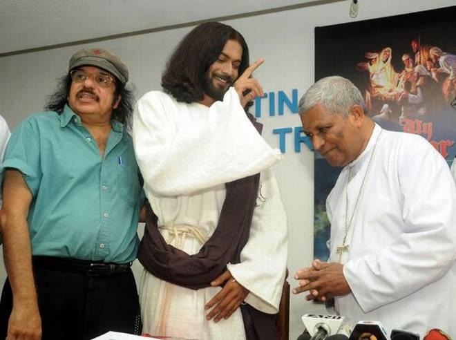 Pratheeksh, who will play Jesus Christ in My Saviour, with cultural activist Soorya Krishnamoorthy and Archbishop of Thiruvananthapuram (Latin rite) Soosa Pakiam M. at the Bishop House on Monday.